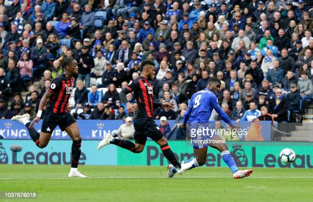 Kelechi Iheanacho of Leicester City scores his team's first goal during the Premier League match between Leicester City and Huddersfield Town at The...