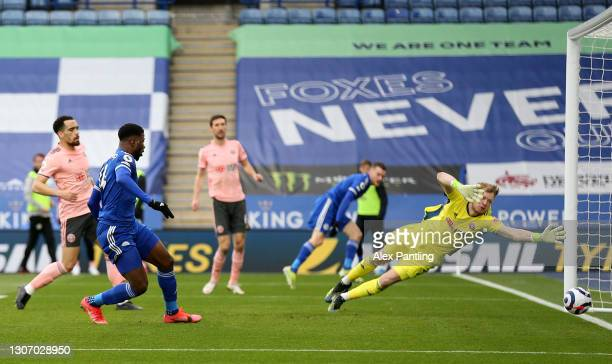 Kelechi Iheanacho of Leicester City scores their side's first goal past Aaron Ramsdale of Sheffield United during the Premier League match between...