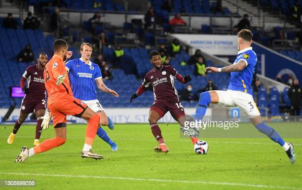 Kelechi Iheanacho of Leicester City scores their team's first goal past Robert Sanchez of Brighton & Hove Albion during the Premier League match...