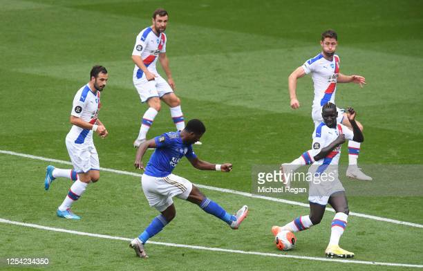 Kelechi Iheanacho of Leicester City shoots and his shot is blocked by Mamadou Sakho of Crystal Palace during the Premier League match between...