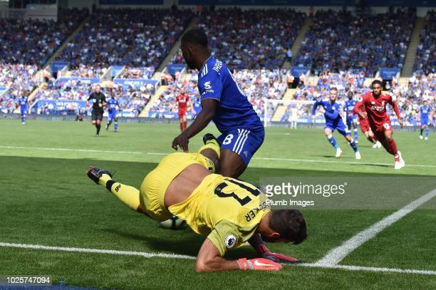 Kelechi Iheanacho of Leicester City steals the ball from Alisson of Liverpool to set up Rachid Ghezzal of Leicester City's goal to make it 12 during...