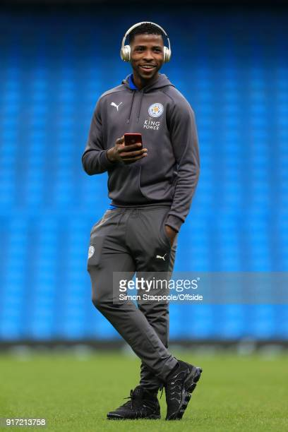 Kelechi Iheanacho of Leicester looks on with hismobile phone in hand before the Premier League match between Manchester City and Leicester City at...