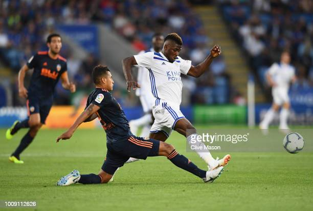 Kelechi Iheanacho of Leiceter City is challenged by Jeison Murillo of Valencia during the preseason friendly match between Leicester City and...