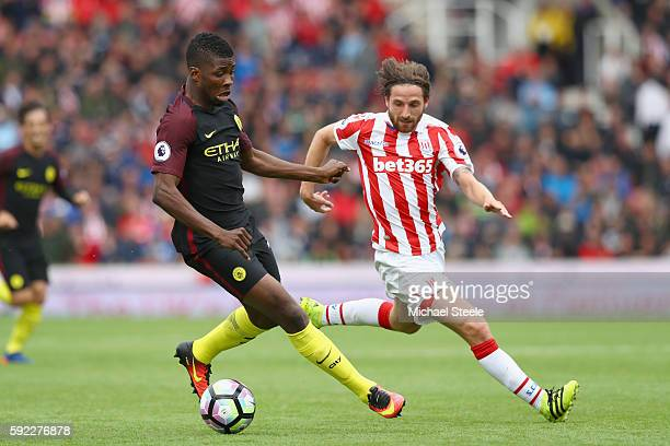 Kelechi Iheanacho of Manchester City and Joe Allen of Stoke City battle for possession during the Premier League match between Stoke City and...