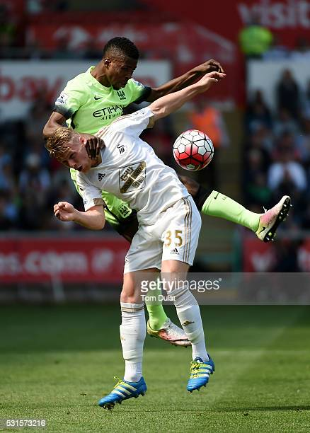 Kelechi Iheanacho of Manchester City and Stephen Kingsley of Swanseae City compete for the ball during the Barclays Premier League match between...