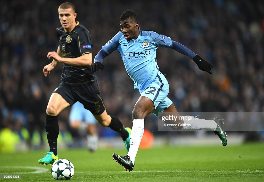 Kelechi Iheanacho of Manchester City (R) breaks through to score his sides first goal during the UEFA Champions League Group C match between Manchester City FC and Celtic FC at Etihad Stadium on December 6, 2016 in Manchester, England.