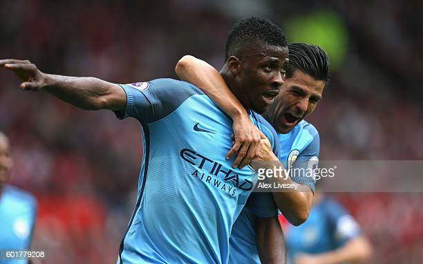 Kelechi Iheanacho of Manchester City celebrates scoring his sides second goal with his team mate Nolito of Manchester City during the Premier League...