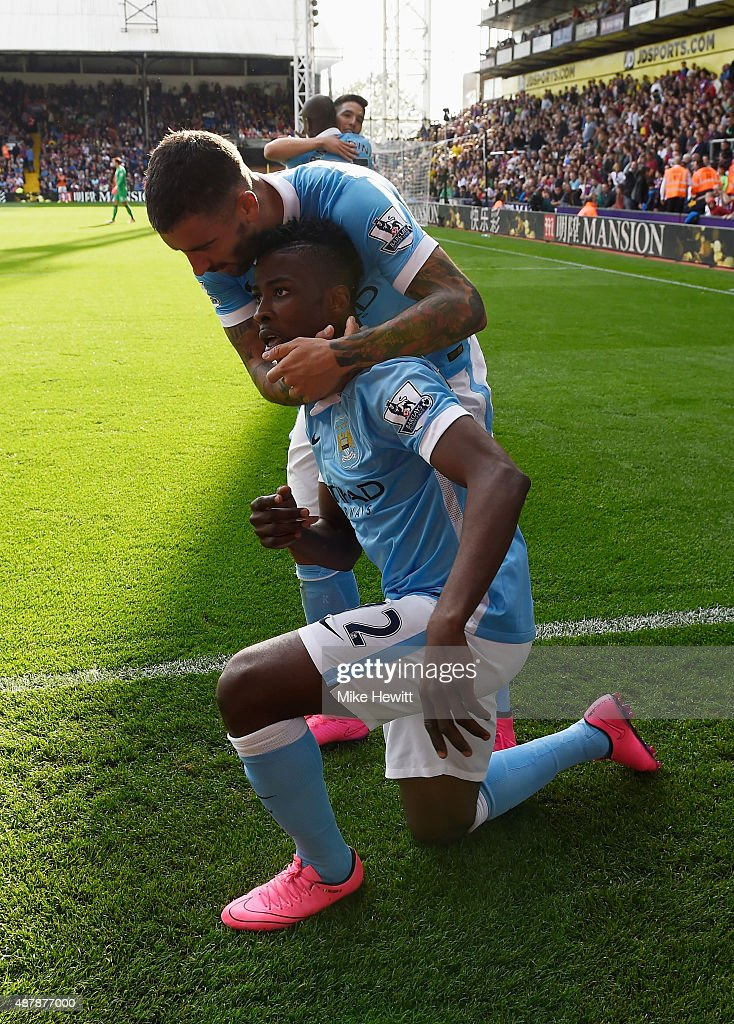 Kelechi Iheanacho of Manchester City celebrates scoring his team's opening goal with Aleksandar Kolarov during the Barclays Premier League match between Crystal Palace and Manchester City at Selhurst Park on September 12, 2015 in London, United Kingdom.