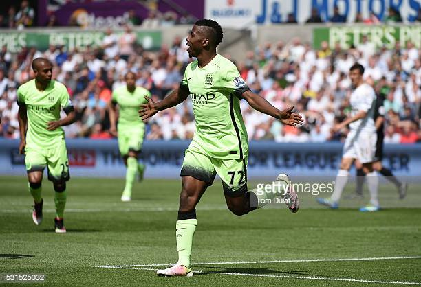 Kelechi Iheanacho of Manchester City celebrates scoring his team's first goal during the Barclays Premier League match between Swansea City and...