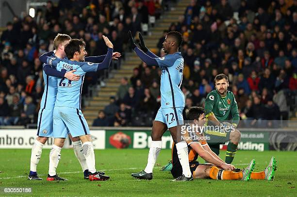 Kelechi Iheanacho of Manchester City celebrates scoring his team's second goal with team mates during the Premier League match between Hull City and...