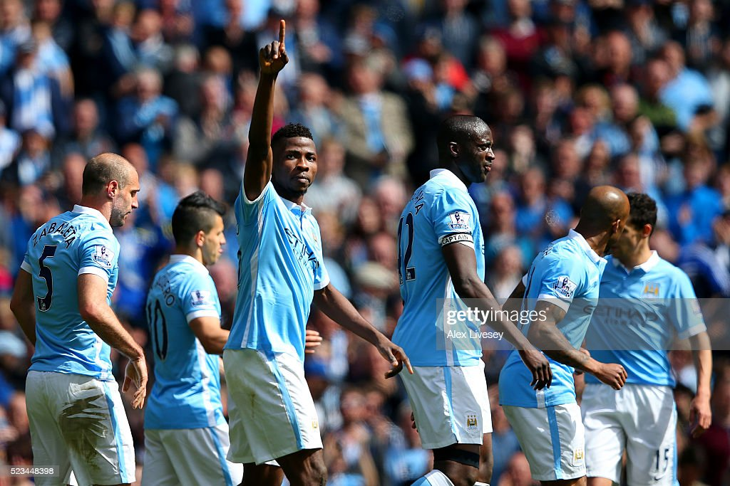 Kelechi Iheanacho of Manchester City celebrates with his team mates following scoring his sides third goal during the Barclays Premier League match between Manchester City and Stoke City at Etihad Stadium on April 23, 2016 in Manchester, United Kingdom.