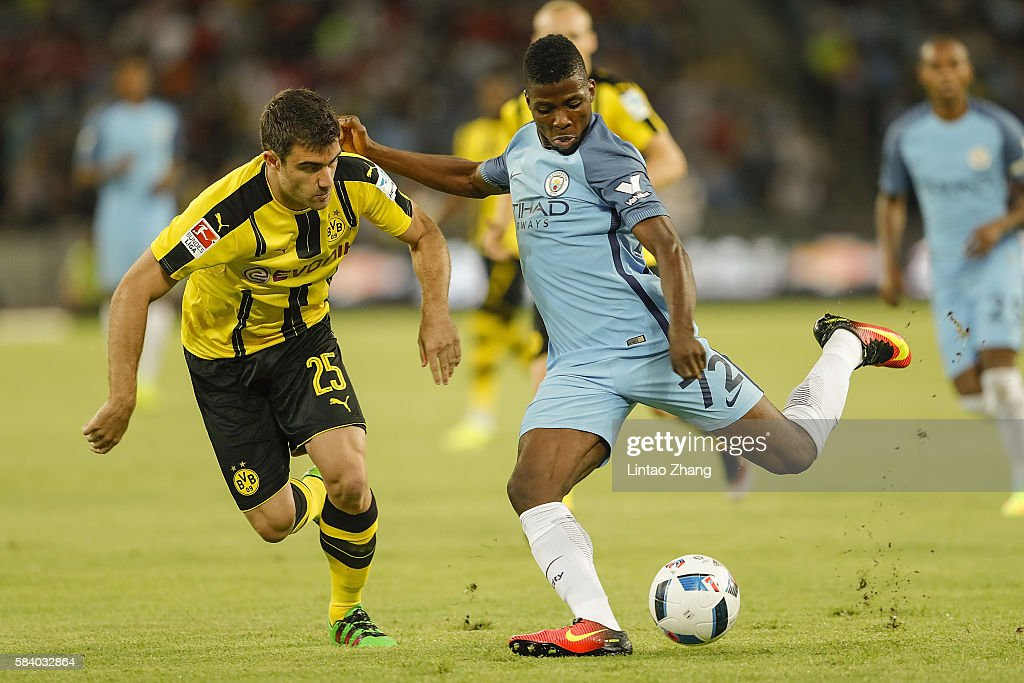 Kelechi Iheanacho (R) of Manchester City contests the ball against Sokratis Papastathopoulos of Borussia Dortmund during the 2016 International Champions Cup match between Manchester City and Borussia Dortmund at Shenzhen Universiade Stadium on July 28, 2016 in Shenzhen, China.