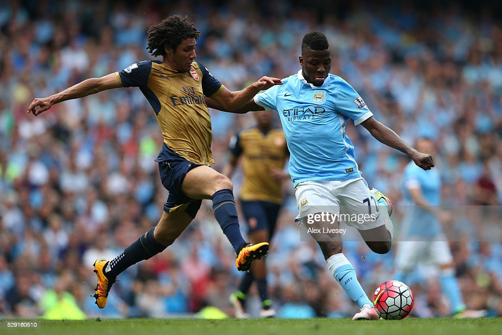 Kelechi Iheanacho of Manchester City holds off Mohamed Elneny of Arsenal during the Barclays Premier League match between Manchester City and Arsenal at the Etihad Stadium on May 8, 2016 in Manchester, England.