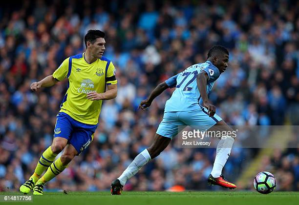 Kelechi Iheanacho of Manchester City is closed down by Gareth Barry of Everton during the Premier League match between Manchester City and Everton at...