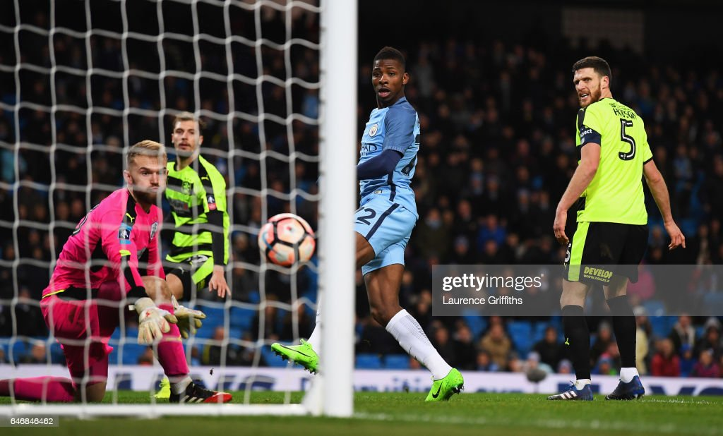Kelechi Iheanacho of Manchester City (C) scores their fifth goal past goalkeeper Joel Coleman of Huddersfield Town during The Emirates FA Cup Fifth Round Replay match between Manchester City and Huddersfield Town at Etihad Stadium on March 1, 2017 in Manchester, England.