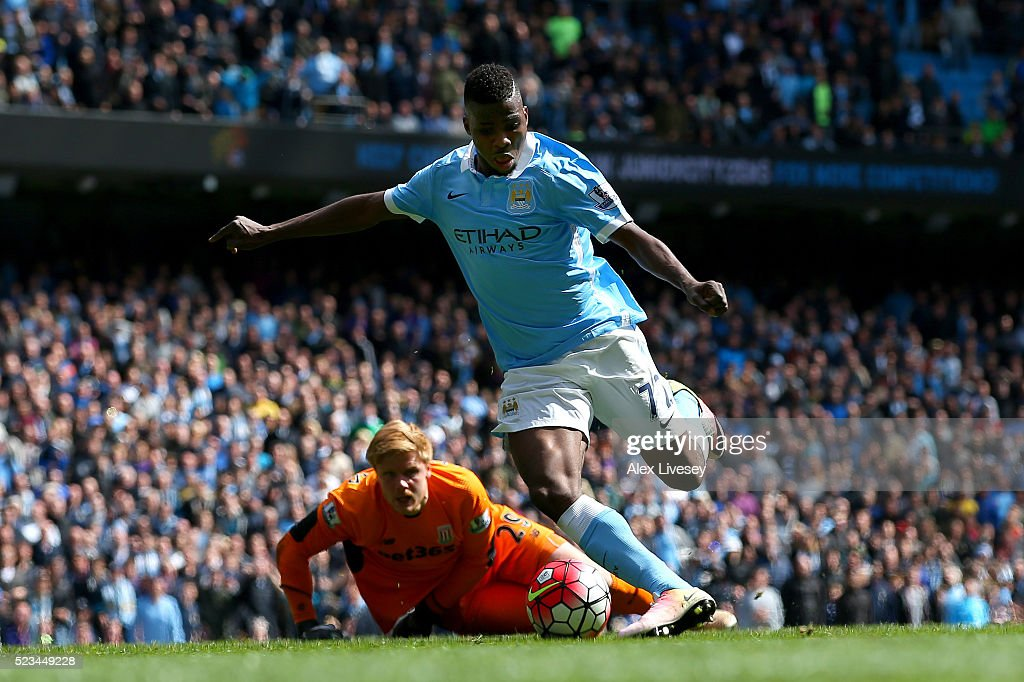 Kelechi Iheanacho of Manchester City takes the ball past Jakob Haugaard of Stoke City to score his second and his sides fourth goal during the Barclays Premier League match between Manchester City and Stoke City at Etihad Stadium on April 23, 2016 in Manchester, United Kingdom.