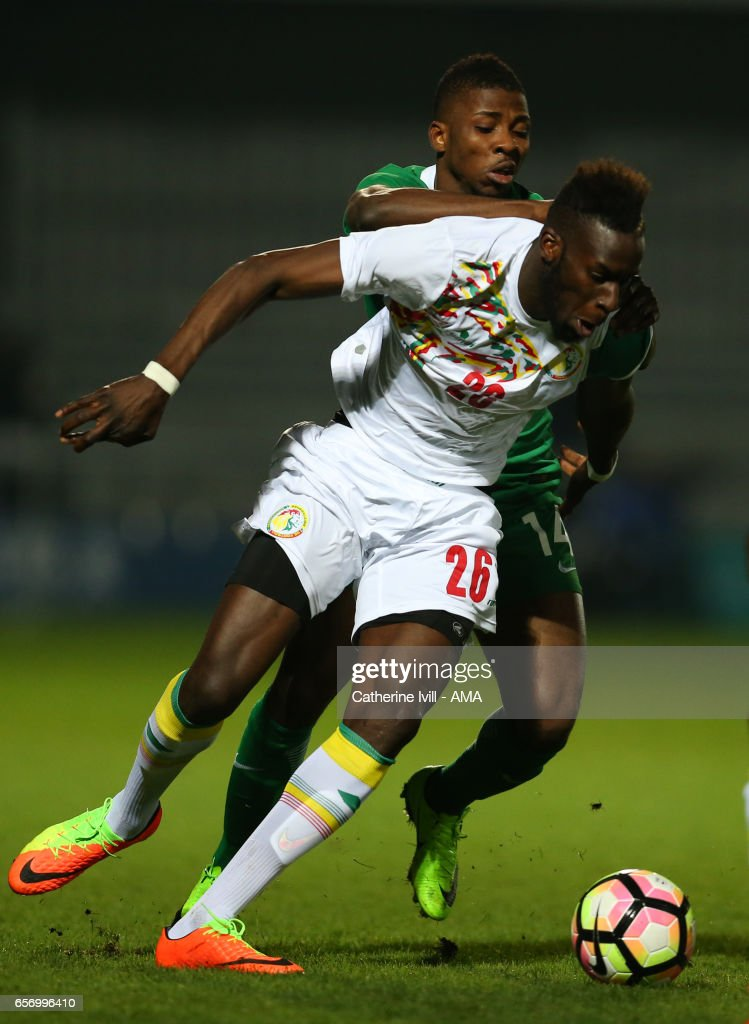 Kelechi Iheanacho of Nigeria and Salif Sane of Senegal during the International Friendly match between Nigeria and Senegal at The Hive on March 23, 2017 in Barnet, England.