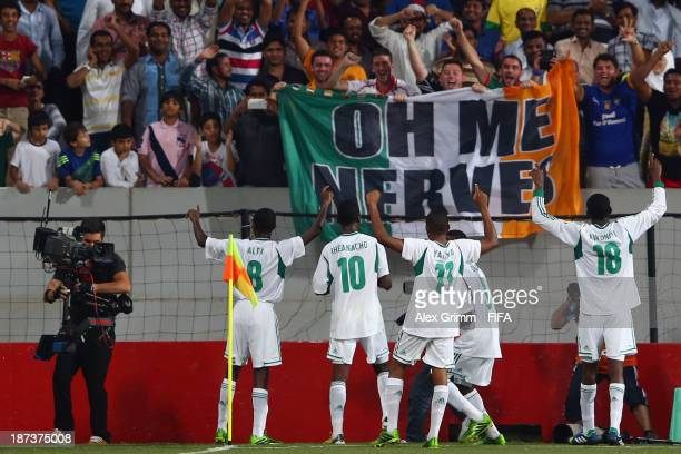 Kelechi Iheanacho of Nigeria celebrates his team's second goal with team mates and fans during the FIFA U-17 World Cup UAE 2013 Final between Nigeria...