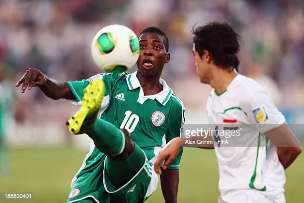 Kelechi Iheanacho of Nigeria is challenged by Mahdi Abdulzahra of Iraq during the FIFA U17 World Cup UAE 2013 Group F match between Nigeria and Iraq...