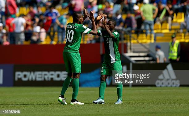 Kelechi Nwakali of Nigeria celebrate with team mate John Lazarus during the FIFA U17 Men's World Cup 2015 quarter final match between Brazil and...