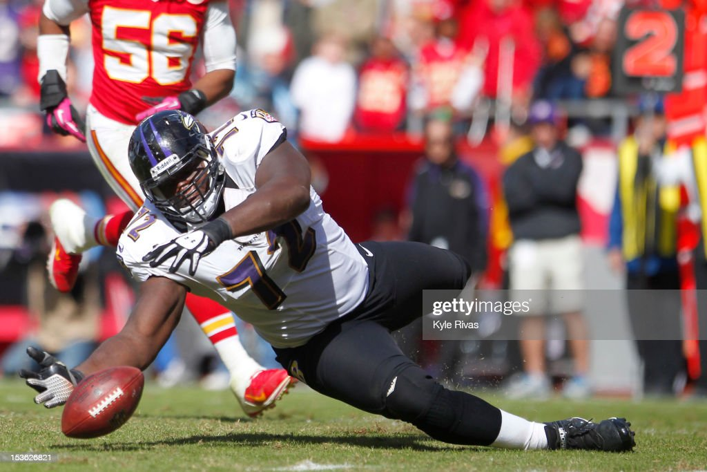 Kelechi Osemele #72 of the Baltimore Ravens attempts to recover a fumble before the Kansas City Chiefs by the twelve yard line late in the fourth quarter on October 07, 2012 at Arrowhead Stadium in Kansas City, Missouri.