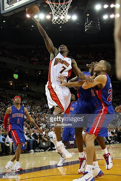 Kelenna Azubuike of the Golden State Warriors lays the ball up over Allen Iverson Jason Maxiell and Tayshaun Prince of the Detroit Pistons during the...