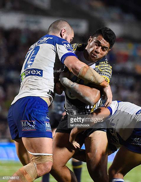 Kelepi Tanginoa of the Cowboys is tackled by David Klemmer of the Bulldogs during the round nine NRL match between the North Queensland Cowboys and...