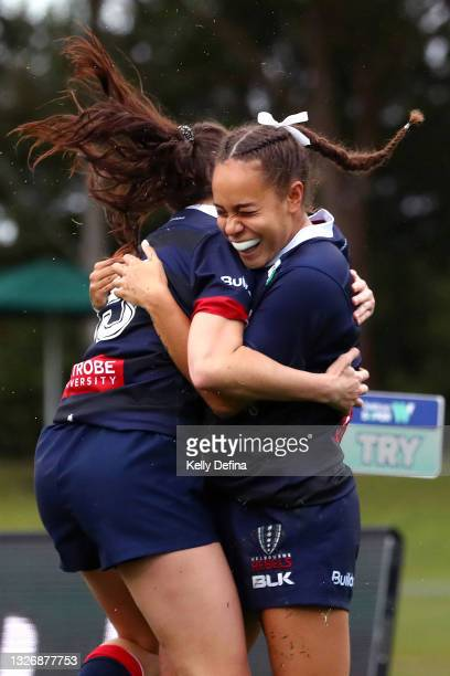 Kelera Ratu of the Rebels celebrates her try with Jemma Collins of the Rebels during the Super W match between the Melbourne Rebels and the ACT...