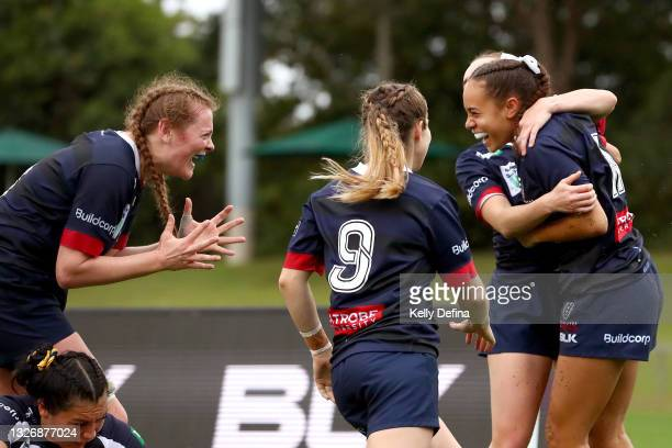 Kelera Ratu of the Rebels celebrates her try with Nuala O'Conner of the Rebels and Georgia Cormick of the Rebels during the Super W match between the...