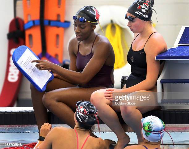 Keleyia Rochelle left and Molly Jordan right speak at a Wellesley High School practice session at the Boston Sports Institute in Wellesley MA on Sept...