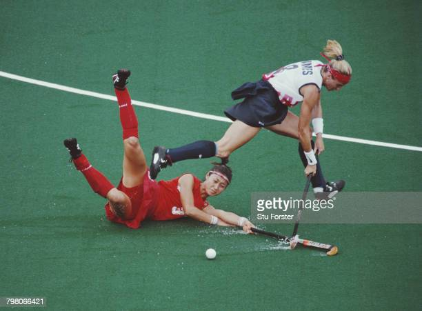 Keli Janes of the USA and EunSung Cho of South Korea fighting for the ball during their Women''s Field Hockey competition preliminary round match on...