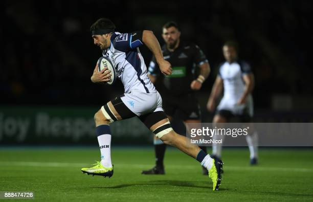 Kelian Galletier of Montpellier breaks through to score his team's secondt try during the European Rugby Champions Cup match between Glasgow Warriors...