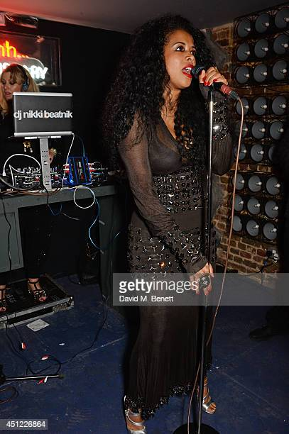 Kelis and DJ Nikki Beatnik perform at the grand opening of LIBRARY on June 25 2014 in London England