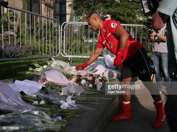 Kell Brook lays flowers in memory of the victims of the Manchester Arena attack during a public workout at the Peace Gardens on May 24 2017 in...