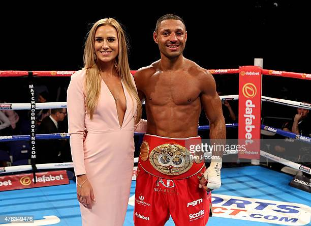 Kell Brook of England poses with his partner Lindsey Myers and the IBF World Welterweight Championship title belt after defeating Frankie Gavin of...