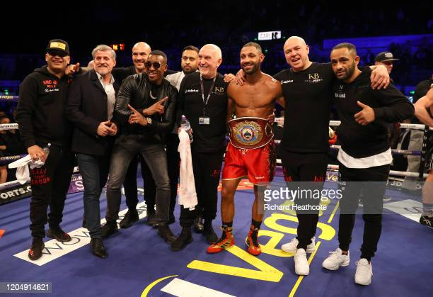 Kell Brook poses for a photo with Bugzy Malone his trainer Dominic Ingle Kid Galahad and the rest of his team after the WBO Intercontiental...