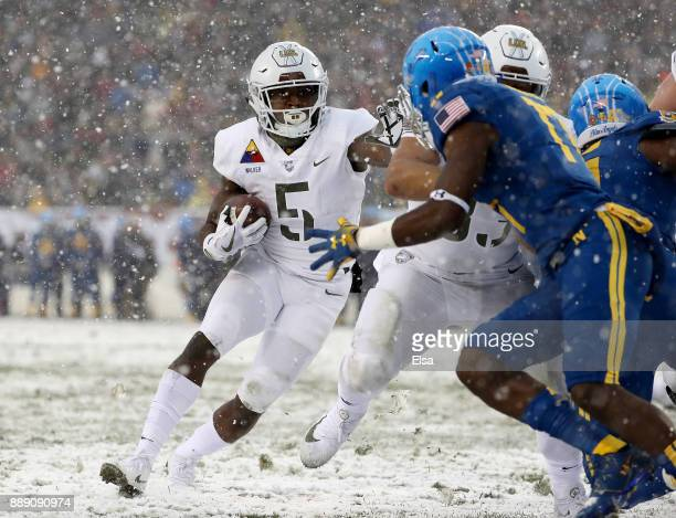 Kell Walker of the Army Black Knights carries the ball in the first quarter against the Navy Midshipmen on December 9 2017 at Lincoln Financial Field...