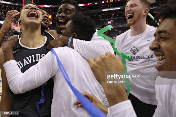 Kellan Grady of the Davidson Wildcats and teammates celebrate after defeating the Rhode Island Rams in the Championship of the Atlantic 10 Basketball...