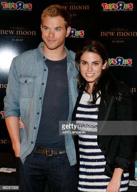 Kellan Lutz and Nikki Reed sign autographs at ''The Twilight Saga New Moon'' promotion at Toys 'R' Us on November 19 2009 in New York City