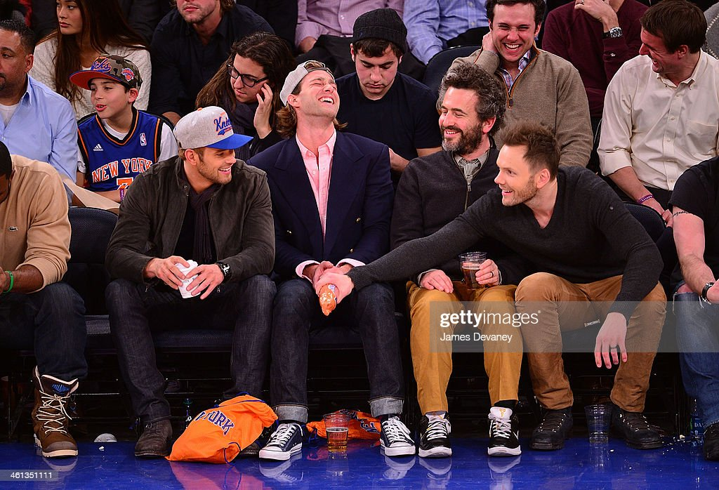 Kellan Lutz, guests and Joel McHale attend the Detroit Pistons vs New York Knicks game at Madison Square Garden on January 7, 2014 in New York City.