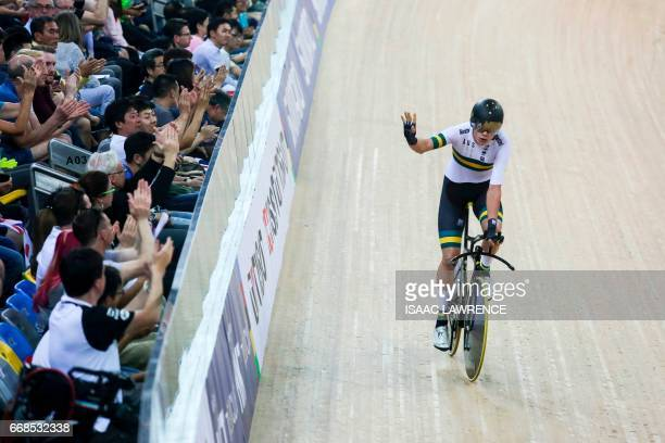 Kelland O'Brien of Australia waves to fans after winning bronze in the Men's Individual Pursuit Final at the Hong Kong Velodrome during the Track...