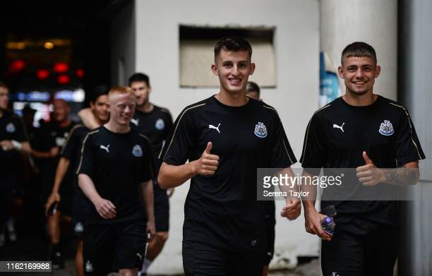 Kelland Watts of Newcastle United and Elias Sorensen give the thumbs up during the Newcastle United Training session at Nanjing Olympic Sports Center...