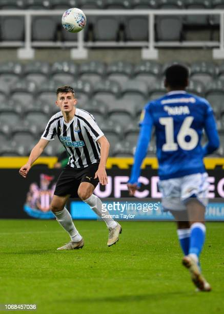 Kelland Watts of Newcastle United heads the ball during the Checkatrade Trophy Match between Newcastle United and Macclesfield Town at StJame's Park...