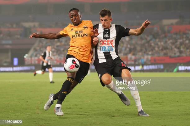 Kelland Watts of Newcastle United in action with Niall Ennis of Wolverhampton Wanderers during the Premier League Asia Trophy 2019 match between...