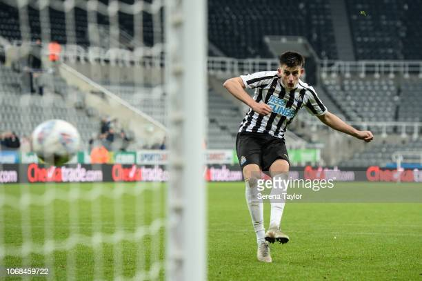 Kelland Watts of Newcastle United scores from the penalty spot during the Checkatrade Trophy Match between Newcastle United and Macclesfield Town at...