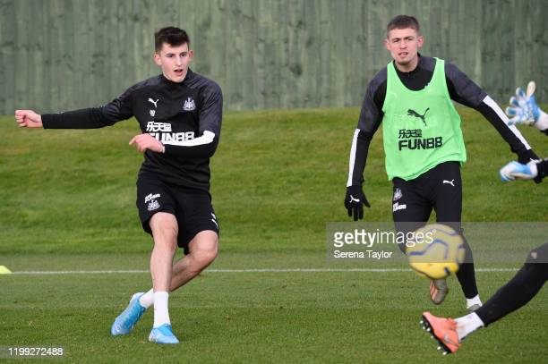Kelland Watts strikes the ball as Elias Sorensen looks on during the Newcastle United Training Session at the Newcastle United Training Centre on...