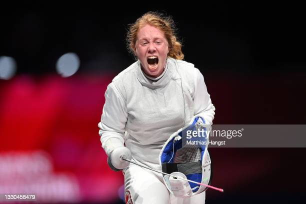 Kelleigh Ryan of Team Canada celebrates after defeating Sera Azuma of Team Japan in Women's Individual Foil first round on day two of the Tokyo 2020...