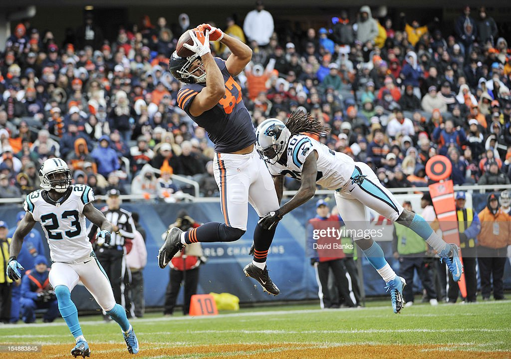 Kellen Davis #87 of the Chicago Bears catches a touchdown pass as Charles Godfrey #30 of the Carolina Panthers and Sherrod Martin #23 defend him on October 28, 2012 at Soldier Field in Chicago, Illinois. The Chicago Bears defeated the Carolina Panthers 23-12.