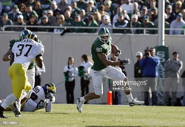 Kellen Davis of the Michigan State Spartans carries the ball during the game against the Michigan Wolverines at Spartan Stadium November 3, 2007 in...