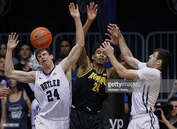 Kellen Dunham and Alex Barlow of the Butler Bulldogs battle for a rebound against Orlando Coleman of the Kennesaw State Owls at Hinkle Fieldhouse on...